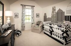 A unique cityscape mural ties this black-and-white Austin-themed nursery together for a boy or girl. West Cypress Hills // Spicewood, TX // Highland Homes // Plan 237