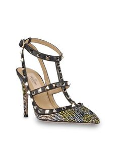 "Valentino rockstud sling back sandal in suede with mimetic-effect swarovski rhinestones. Platinum finish studs. Two adjustable leather straps. Heel height 100 mm - 3.9""."
