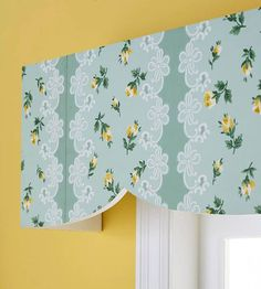 Fabric Fake-Out  If you like the look of fabric but your how-to skills lean more woodshop than workroom, try this nifty look-alike. Cut boards in the shape of a valance, attaching the front and sides. Cover the wood with a coat of primer and paint, then finish with a happy floral wallpaper that portrays a fabric look without a lick of sewing. Attach the valance to the wall with L-brackets.