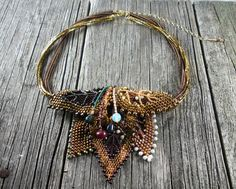 http://randomcreative.hubpages.com/hub/Beaded-Beadwoven-Leaves-Stand-Alone-Projects-As-Components-and-Cuff-Designs