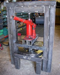 Hydraulic Press Homemade hydraulic press constructed from square steel tubing and a bottle jack