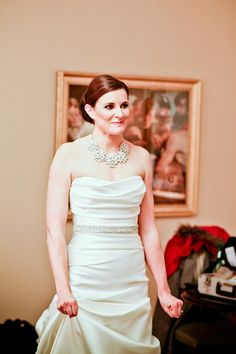 Statement necklace with a strapless Wedding Gown With Rhinestone Waist Detail