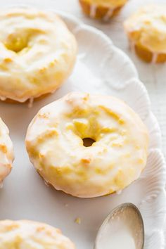 Baked Lemon Donuts with Lemon Glaze - They taste like the Starbucks lemon loaf, but in donut (or mini muffin) form!! Easy, no mixer recipe with a tart-yet-sweet lemon glaze that's PERFECT! Lemon lovers will adore them!!