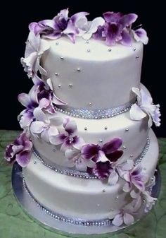 White Wedding Cakes wedding cake in white and purple.jpg - This wedding cake in white and purple serves 80 . Purple Cakes, Purple Wedding Cakes, Wedding Dress Cake, Purple Wedding Flowers, Wedding Flower Decorations, Beautiful Wedding Cakes, Gorgeous Cakes, Pretty Cakes, Bling Wedding