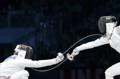 Photos of the Year 2012 - The Wall Street Journal. Germany's Britta Heidemann, left, fenced against South Korea's A Lam Shin during their women's epee semifinal bout July 30 in London. Alberto Pizzoli/AFP/Getty Images