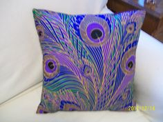 Peacock pillow via Etsy.