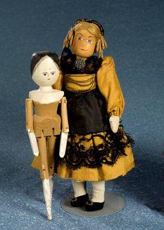 wooden dolls by gingerbread cottage, via Flickr