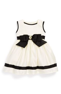Free shipping and returns on Dorissa Sleeveless Satin Dress (Baby Girls) at Nordstrom.com. A shimmery crystal accents the bold, contrasting bow of a festive sleeveless dress finished with a flouncy tulle-lined skirt.