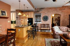 Downtown condo with open-floor plan and lots of exposed brick.