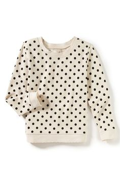 Bold polka dots add playful pep to this comfy cotton-blend pullover with distressed edges for an instant old-favorite look and feel.