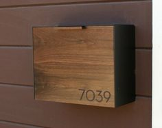 This Stainless Steel and Walnut mailbox measures 18W x7.5H x 5.5D. I designed this mailbox after the 1950s black mailbox that used to hang on my house.