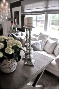 flowers, silver candelsticks, chandelier over the coffee table, pillows..lots of them - romantic