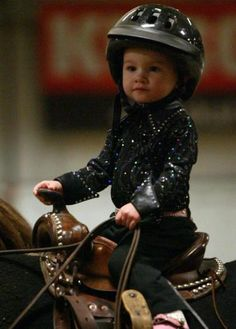 """A month shy of her 2nd birthday - Hannah Sewell, of Saskatoon, Saskatchewan, Canada - shows perfect form while riding """"Mr. Sylvester"""" owned by the Beaudette family, in the leadline class at the SPHC Harvest of Colors Show."""