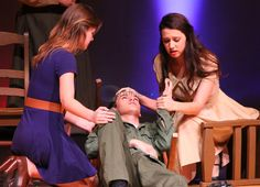 Two nurses (JJ Van Deventer, left, and Iliana Herrera, right) tend to a wounded soldier, Will Lively, in Robert E. Lee Theatre's