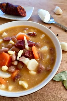 Bean soup a la Jokai is one of the most popular comfort foods in Hungary. A slowly cooked soup with smoked meat, beans, vegetables and noodles. Hungarian Cuisine, European Cuisine, Hungarian Food, Veggie Recipes, Soup Recipes, Cooking Recipes, Veggie Food, Bread Recipes, Cooking Tips