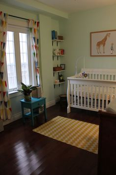 Simple gender-neutral nursery. I like the plant and open space. Definitely need a comfy chair.