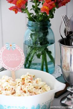 mmmm.  pop kettle corn, drizzle with white chocolate and then pink tinted chocolate.