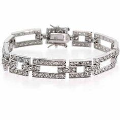 Sterling Silver Simulated Diamond cz Rectangle and Square Link Bracelet - Slender and attractive simulated Diamond cz squares and rectangles are linked together by regal cz bars in this aristocratic bracelet.      Product Details              Width:     11 mm       Clasp Type:     Figure Eight        Stone Details: