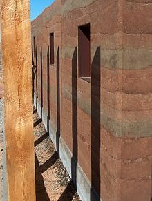 Rammed earth trombe wall built by DesignBuildBLUFF, a non-profit organization based in Park City, Utah. Rammed Earth Homes, Rammed Earth Wall, Eco Buildings, Ancient Buildings, Sustainable Building Materials, Sustainable Architecture, Raw Materials, Natural Building, Green Building
