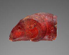 Ram's Head Pendant, Etruscan, 525–480 B.C. Amber, L: 3.6 cm (1 2/5 in.), W: 2 cm (4/5 in.), D: 1.8 cm (7/10 in.). Los Angeles, The J. Paul Getty Museum, 76.AO.82. Gift of Gordon McLendon.