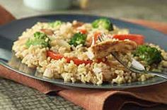 20-Minute Chicken & Rice Stir-Fry: Tbsp.  oil, 2cups  small fresh broccoli florets, 1large  red pepper, cut into strips, 1  onion, cut into 1/4-inch-thick slices halved, 1-3/4cups  water, 1/3cup  lite soy sauce, 2cups  instant white rice, uncooked, 12 oz Grilled Chicken Breast