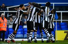 Newcastle's players gather in the Birmingham half to celebrate going ahead in the FA Cup