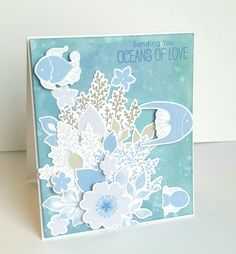 A fun floral & fish Card created using My Favorite Things stamp & dies, altenew inks, Distress oxide inks.