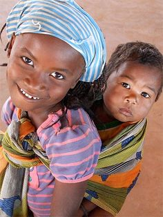 """""""He ain't heavy, he's my brother."""" (?)   Mozambique, Africa"""