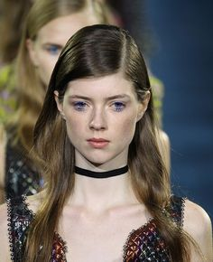 "Mary Katrantzou's collection was a kaleidoscope of colors and prints, so the makeup look was kept clean, save for clumped blue lashes that Pieroni called ""slightly retro with a doll-like feel."" She applied MAC acrylic paint only on lashes that spanned the width of the iris for an open-eye effect."