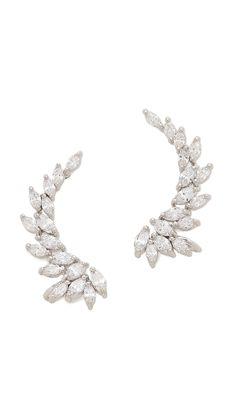 Kenneth Jay Lane Marquis Winged CZ Ear Crawlers: http://www.stylemepretty.com/2016/05/15/unique-bridal-accessories-wedding/
