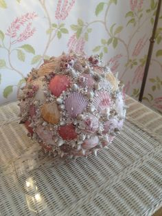 Turn shells collected on the beach into a stunning decorative seashell ball.