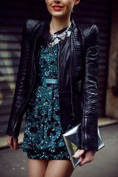 Love how this teal sequined party dress peeks out from under a leather jacket for an edgy look.