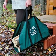 """Green Firewood Carrier with Black Trim.  This large 23"""" Wide x 43"""" Long canvas log carrier permits carrying substantial wood loads without leaving a trail of wood chips and debris. Even with sizable logs, the additional canvas provides an apron that will keep your house and hearth areas neat and clean. This canvas carrier is constructed of rugged 10 oz. canvas duck.  #logcarrier #firewoodcarrier"""