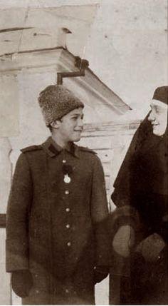 Tsarevich Alexei Nicholaevich with nurse Klavdia Mikhailovna Bitner. C 1917