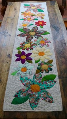 Blossoms Table Runner Paper Pattern – Free Bird Quilting Designs 2019 - - Wedding Decorations 2019 - World TrendsThe Blossoms table runner is an easy project perfect for a quick finish. The appliqué is made up of simple shapes and is laid onto the Mini Quilts, Small Quilts, Lap Quilts, Quilt Blocks, Table Runner And Placemats, Quilted Table Runners, Patchwork Table Runner, Quilted Table Runner Patterns, Quilted Table Toppers
