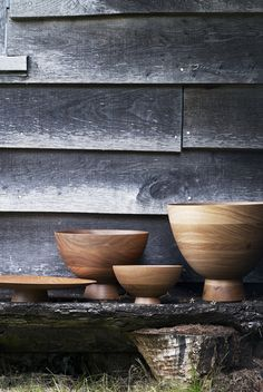 Large wooden bowls against grey wood walls (by Adrian Briscoe)