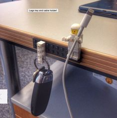 Use a Lego person as cable organizer and a Lego piece as a key ring