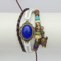 Leather and cord friendship bracelet decorated with trinkets