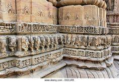 Intricate stone carved elephants on the walls of Sabha Mandap depicting stories from Hindu Epic Mahabharata. The - Stock Image