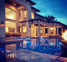 loving the back of this.... with open doors, high windows, and POOL!