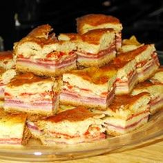 Antipasto Squares ~ a HUGE hit at parties ~ so bring a double batch! Layers of meats and cheeses, with roasted peppers, sandwiched between a crescent roll crust. Good hot, cold or at room temperature!  This dish is great for picnics and tailgaiting too!