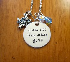 "Disney's Alice in Wonderland Inspired Necklace. Quote ""I am not like other girls"" with a white rabbit charm and two Swarovski crystals. By WithLoveFromOC, $21.00"