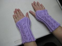 Cable-stitch knitted wristlets.
