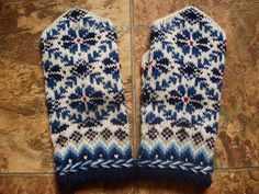 Hand knitted wool mittens. Blue tinted floral by mittenssocksshop