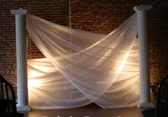 Sheer layers of fabric draped over each other.  Not a fan of pilars but love the backlight.