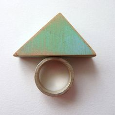 Triangle ring with silver base