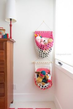 Fabric or t-shirt yarn hanging baskets for a kids room.