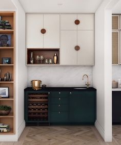 """Between the kitchen and dining rooms is a """"pass-through"""" bar or servery, with dark turquoise base cabinets with an integrated wine fridge and bar sink. Home Wet Bar, Bars For Home, Estudio Makeup, Home Bar Designs, Bar Sink, Base Cabinets, Kitchen Cabinets, Dining Room Bar, Dining Rooms"""