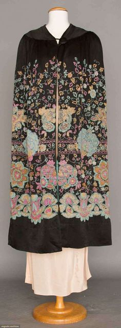 HEAVILY BEADED EVENING CAPE, 1920s Black silk crepe, large scale beaded Persian blossoms in pink, blue & yellow