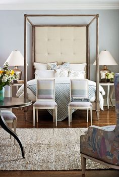 Natural rug w/fine furnishings beautiful bedroom symmetry, pared back metal four poster bed metallic lamps
